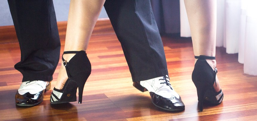 Couple utilizes their ballroom classes together on the dance floor