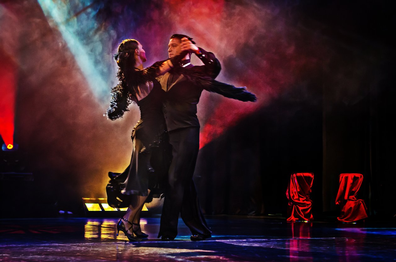 Dancing with the Stars.Man and woman dancing the tango on a stage similar to dancing with the stars