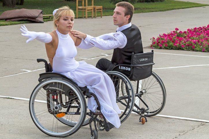 An elegant pair of Valery and Elena wheelchair dancing. The festival, entitled 'People with great potential'. Performance in Park City. Wheelchair dance classes
