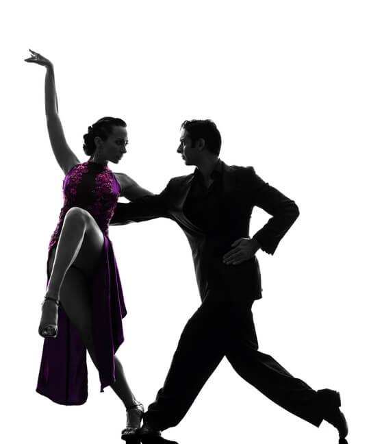 Couple man and woman ballroom dancers tangoing silhouette