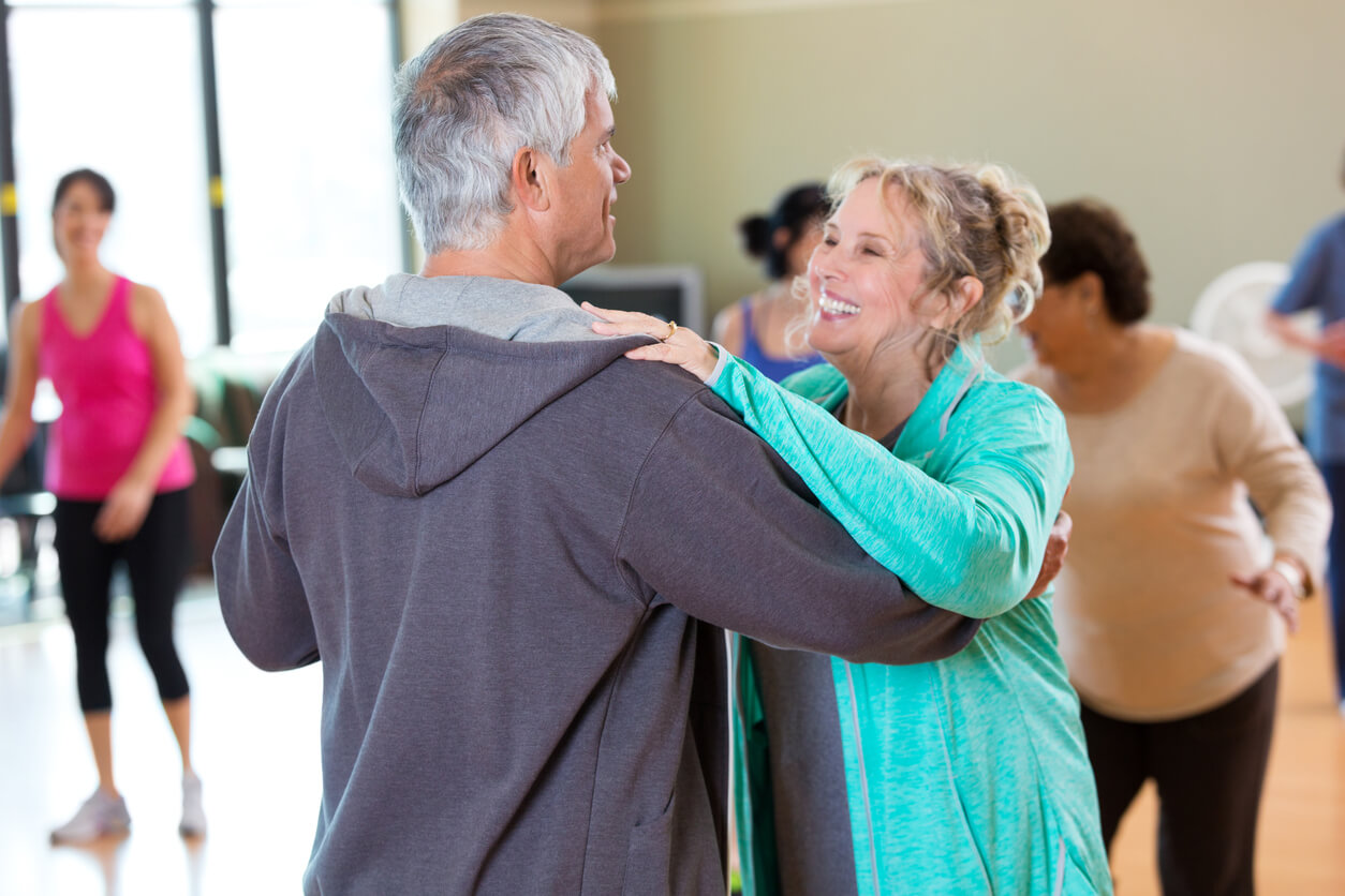 Happy senior couple take ballroom dancing lessons and enjoying the many physical benefits of adult social dancing