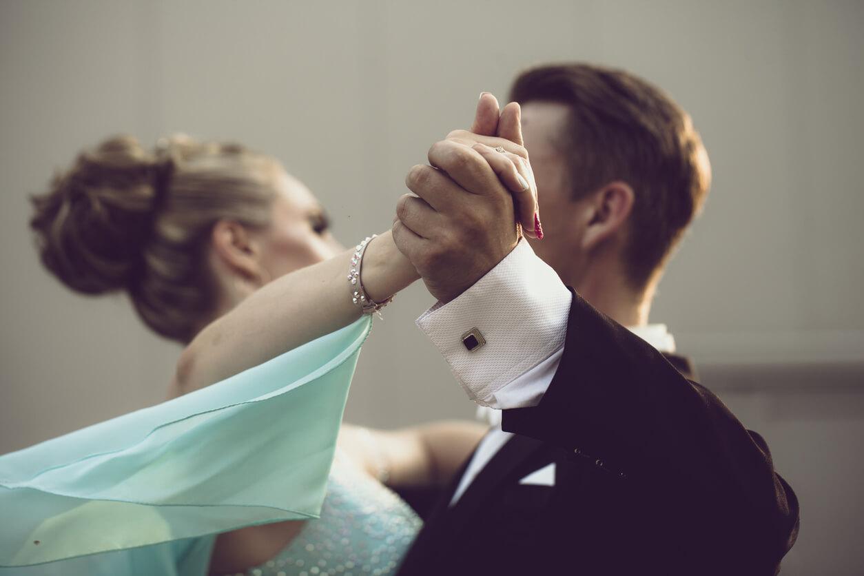 Ballroom Dancing the Waltz.Elegant couple practices the Waltz in a ballroom dance class