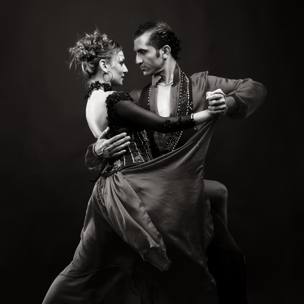 Dancing Couple.Black and white photo of two people ballroom dancing deep emotion