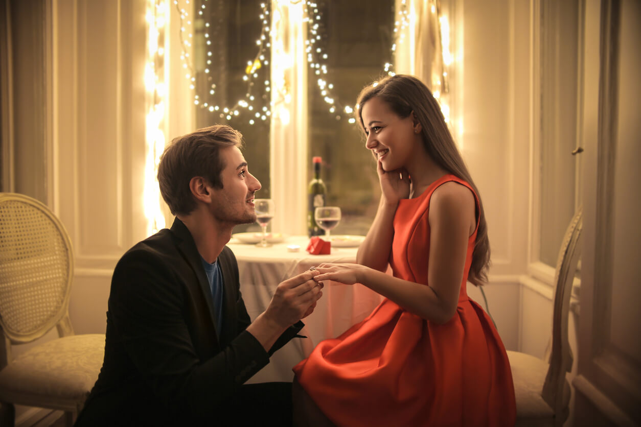 Engagement proposal. Man proposes to woman at a romantic restaurant - engagement