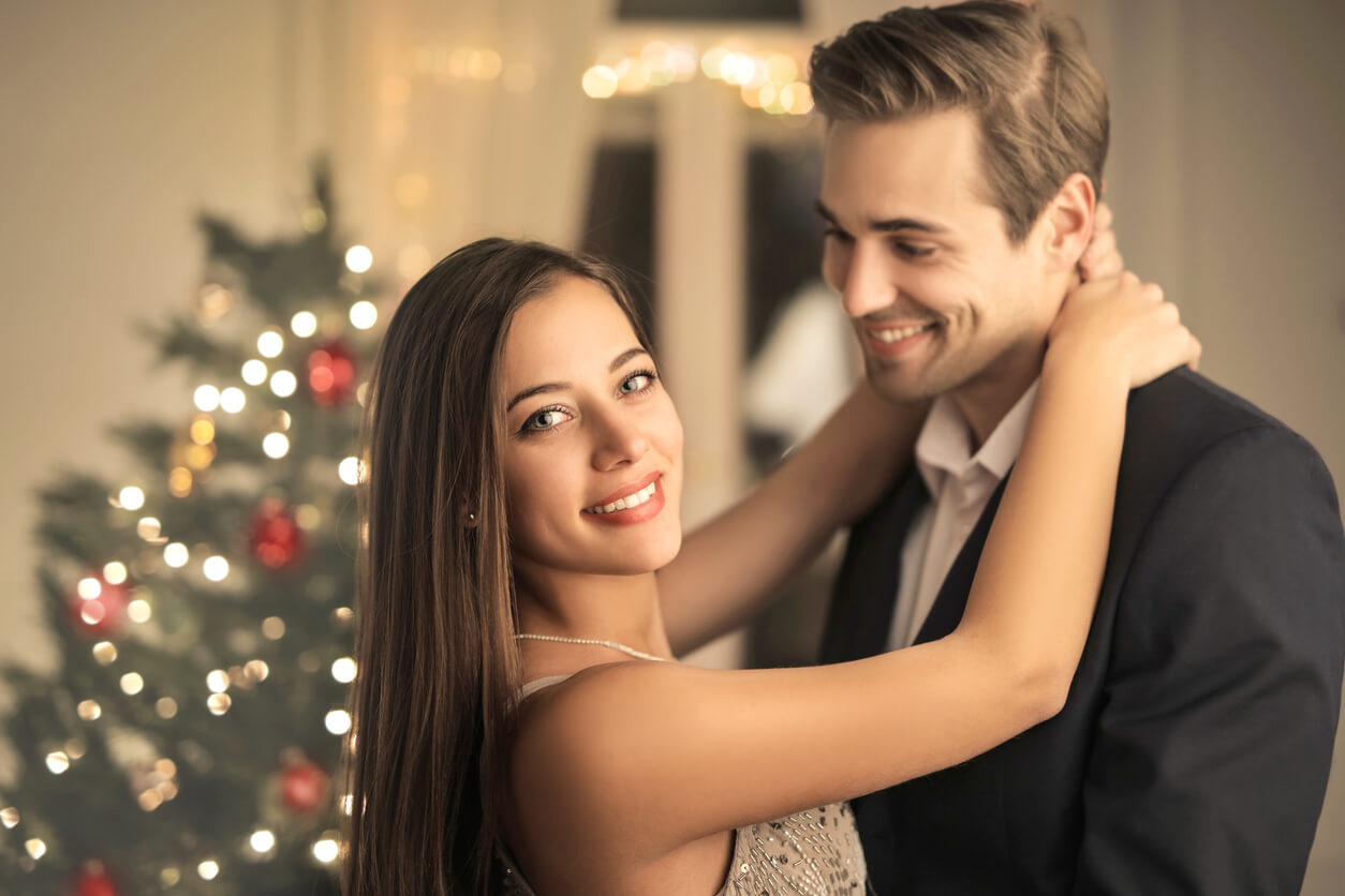 Holidays - Beautiful couple celebrating the holidays with ballroom dance lessons