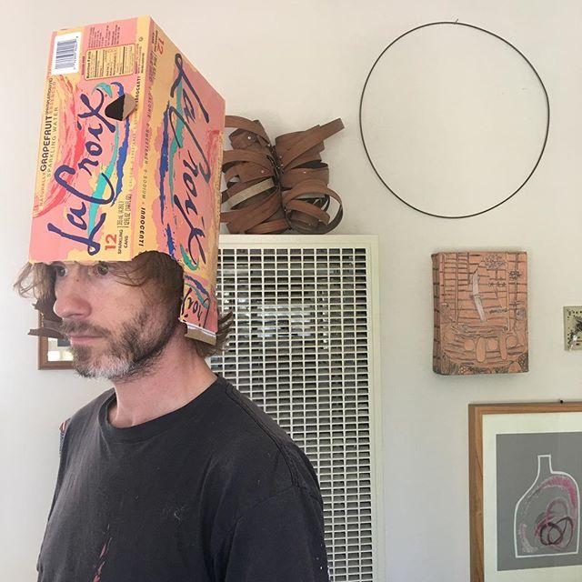 he makes hats.
