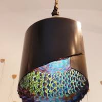 Modern Craft Metal Pendant, Green Blues illuminated inside.