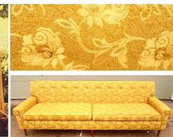 The sofa, here in a two tone golden colour, with floral pattern.