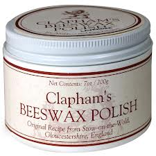 Beeswax is a fantastic polish alternative - natural carcinogenic FREE! Can be purchased at your health store, Greenworks Hardware, and some Home Hardware stores.