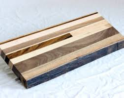 A custom wood square  spindal could be created, then staining the grains to bring out the wood - dramatic!