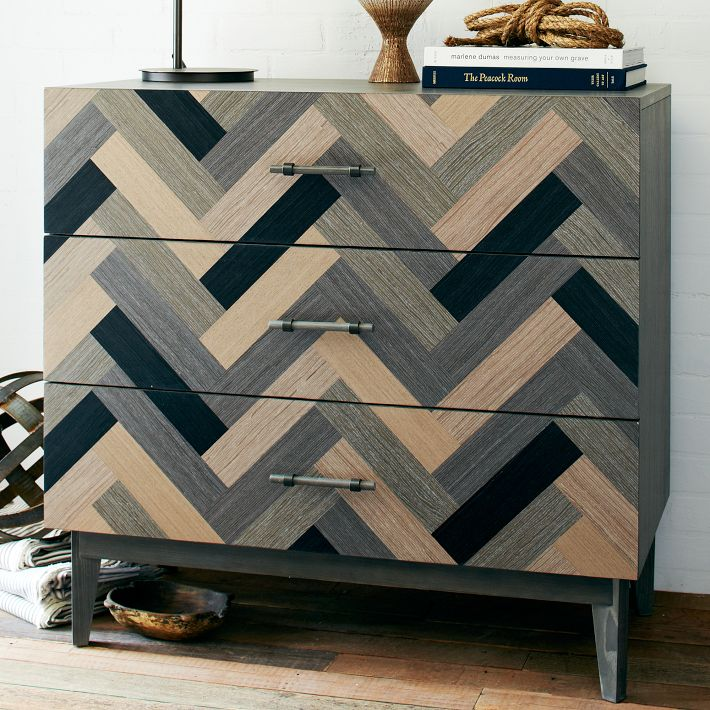 This dresser is from West Elm and makes a great side board for linens n' such. Love the movement with the herringbone pattern.
