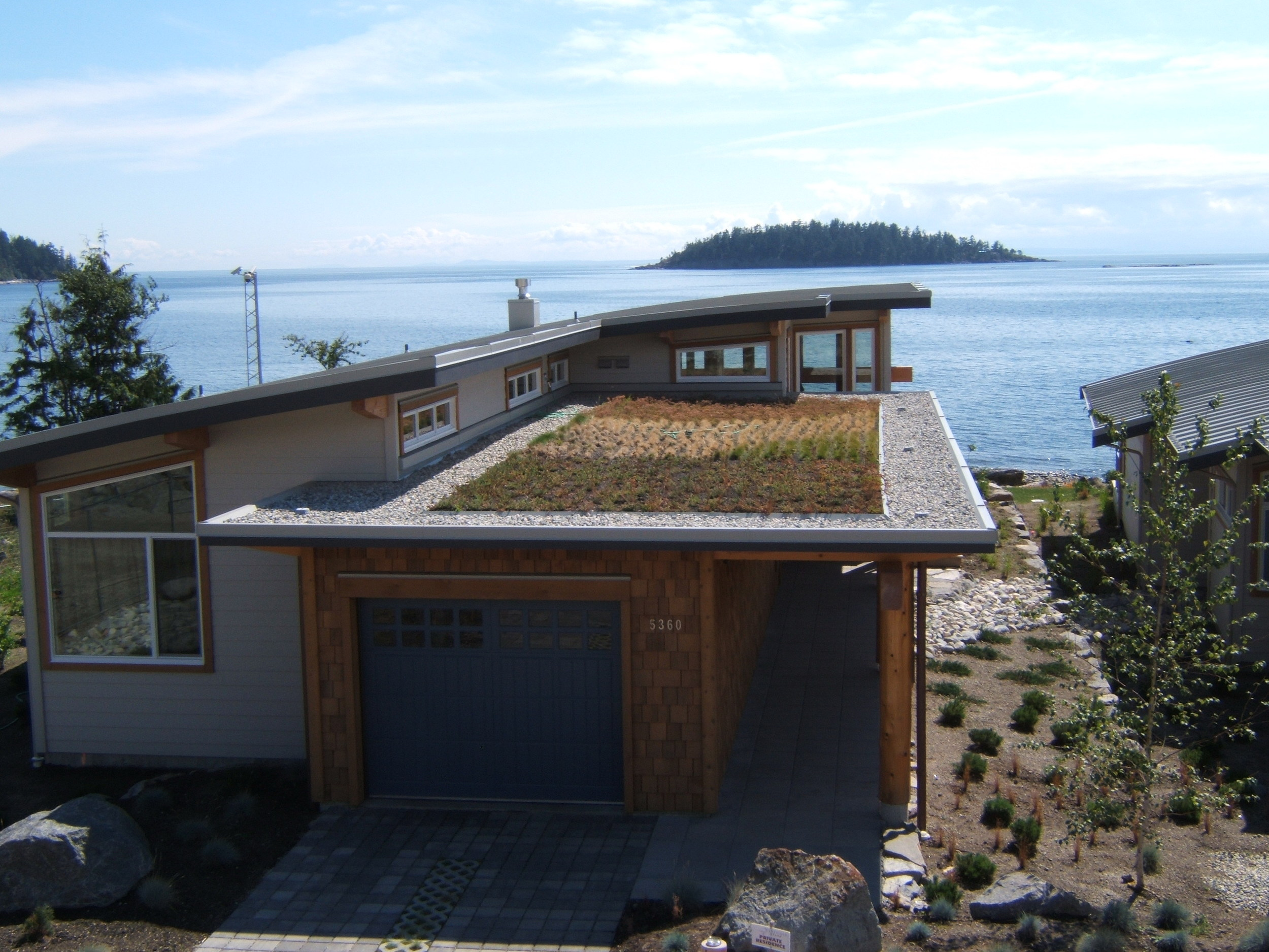 Nelson Roofing Company, Sea Schelt coastal BC - modern style with a incorporated green roof design.