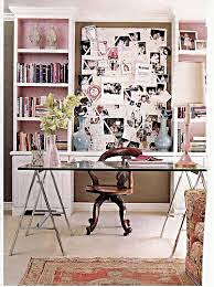 A vintage Pink home office....the glass tressel top gives the effect of a light space.