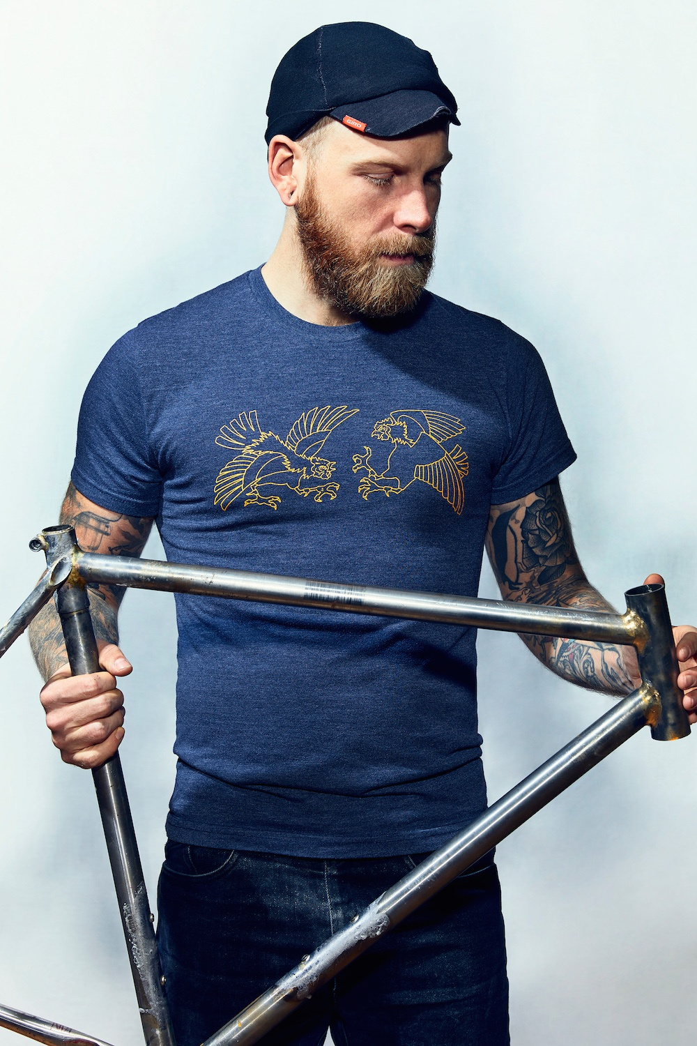 Mechanic-holding-bike-frame.jpg
