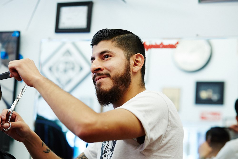 Barber-working-Belmont-Barbershop-smiling.jpg