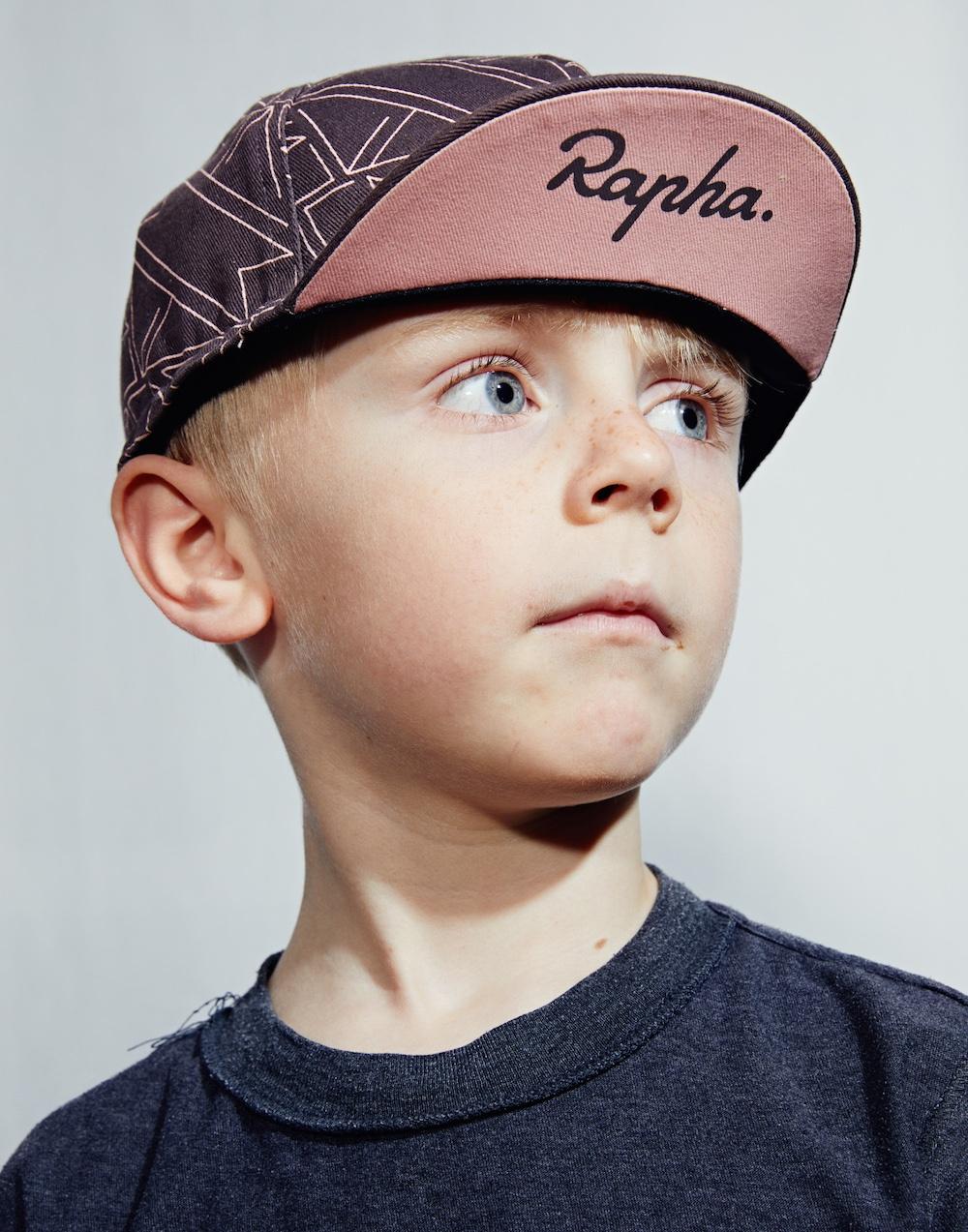 Boy-wearing-pink-black-cap.jpg