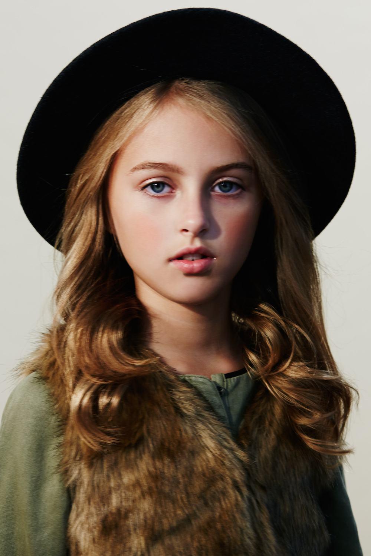 Girl-hat-looking-straight-camera.jpg