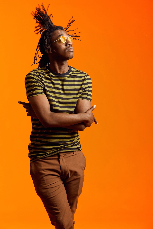 Folded-arms-portrait-bright-orange-bakcground.jpg