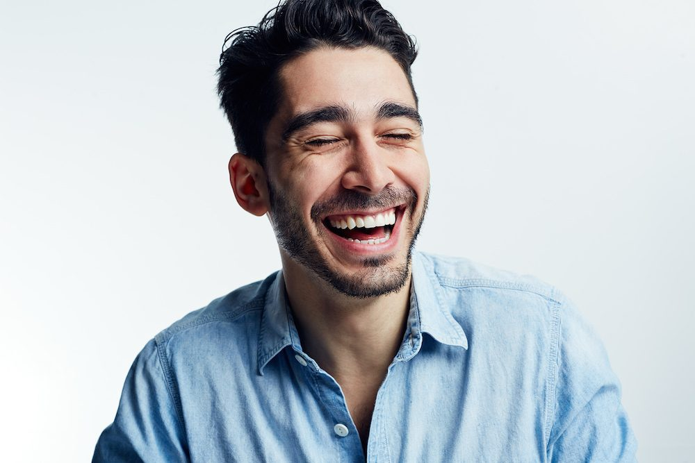 Candid-laugh-white-background-man.jpg