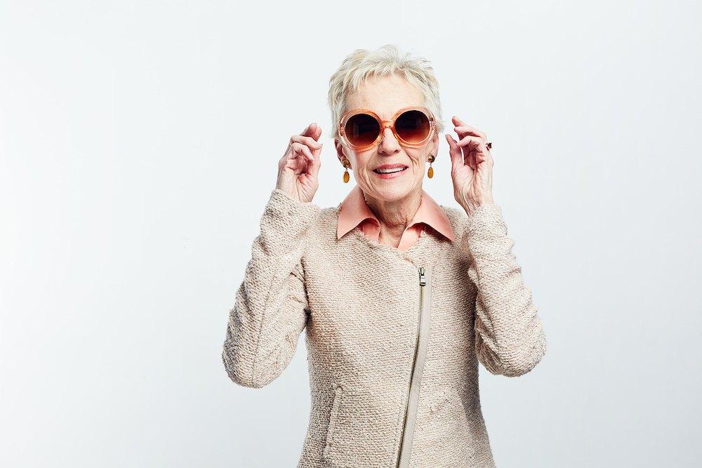 Lady-large-sunglasses-off-white-jacket.jpg