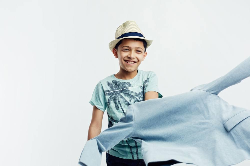Boy-putting-on-blue-jacket.jpg