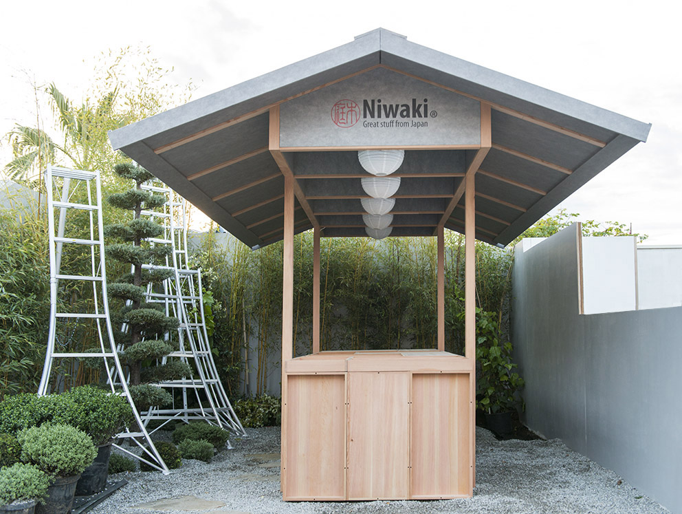 Niwaki Pavilion, RHS Chelsea Flower Show  May 2017  A temporary pavilion showcasing Niwaki's Japanese tools, Niwaki's stand was awarded four stars at Chelsea Flower Show this year. Made with a Douglas fir structure, the silver fleece membrane covering the roof protects from rain and sun in equal measure.