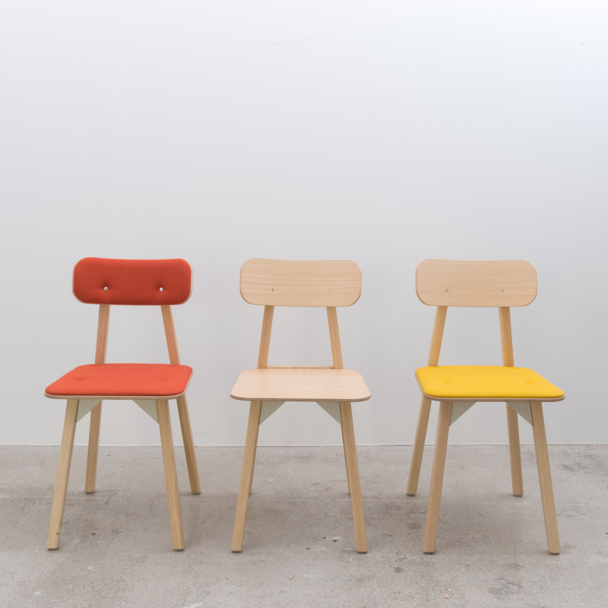Upholstered and Ash ply variants