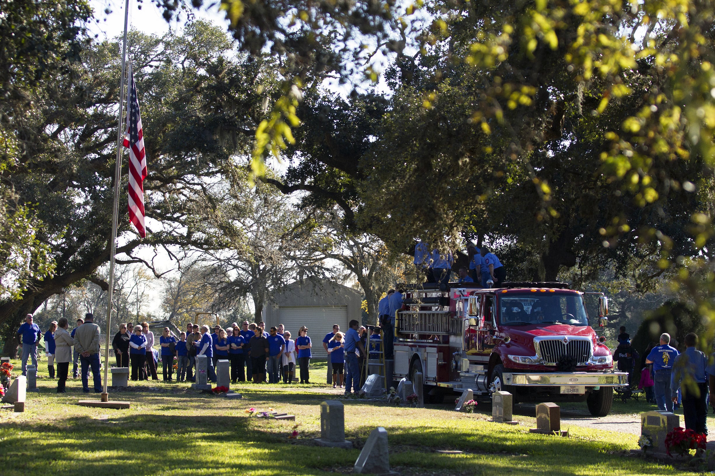 Henry's casket is unloaded from a firetruck at Red Bluff Cemetery in Lolita, TX.