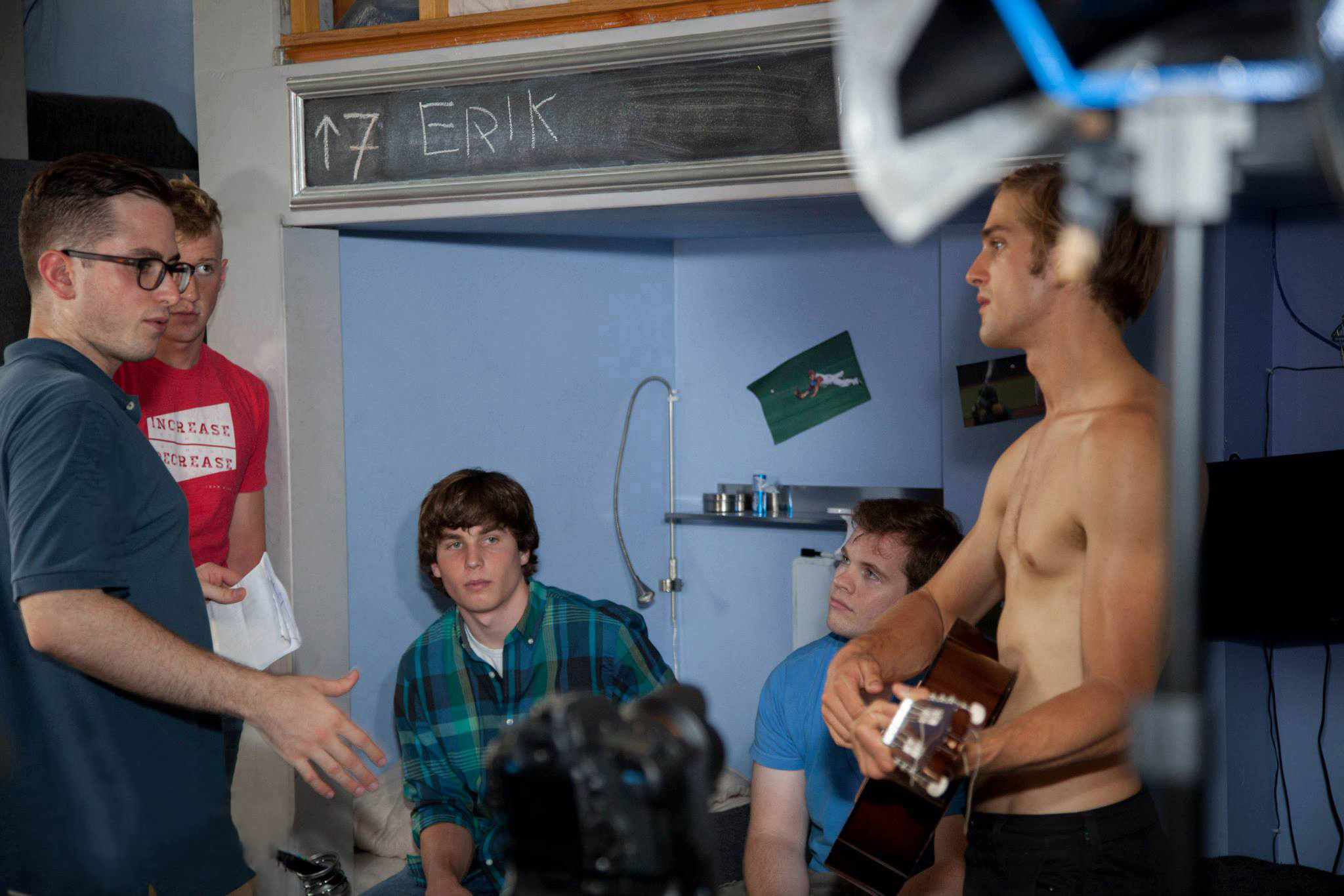 Director Benjamin Walter rehearses a scene with the male cast of PINK ZONE.