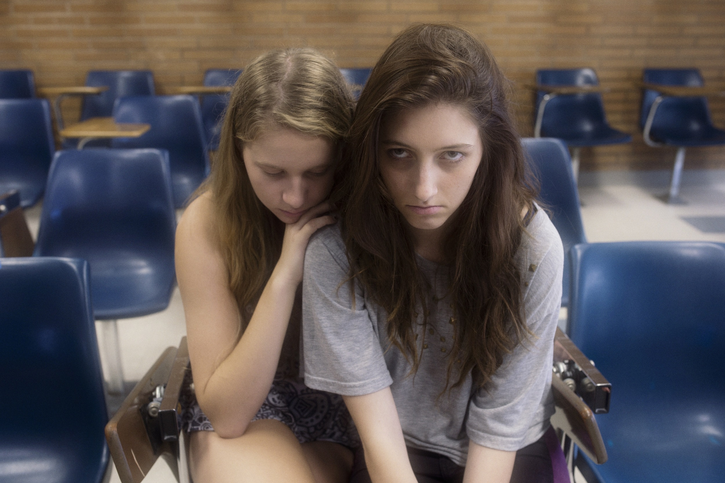 The few girls who survived the virus outbreak are now trapped into the Pink Zone. Most of them, like Joan (Tara Leahy, left) and Nicole (Violet Leona Paley, right) lost their parents.