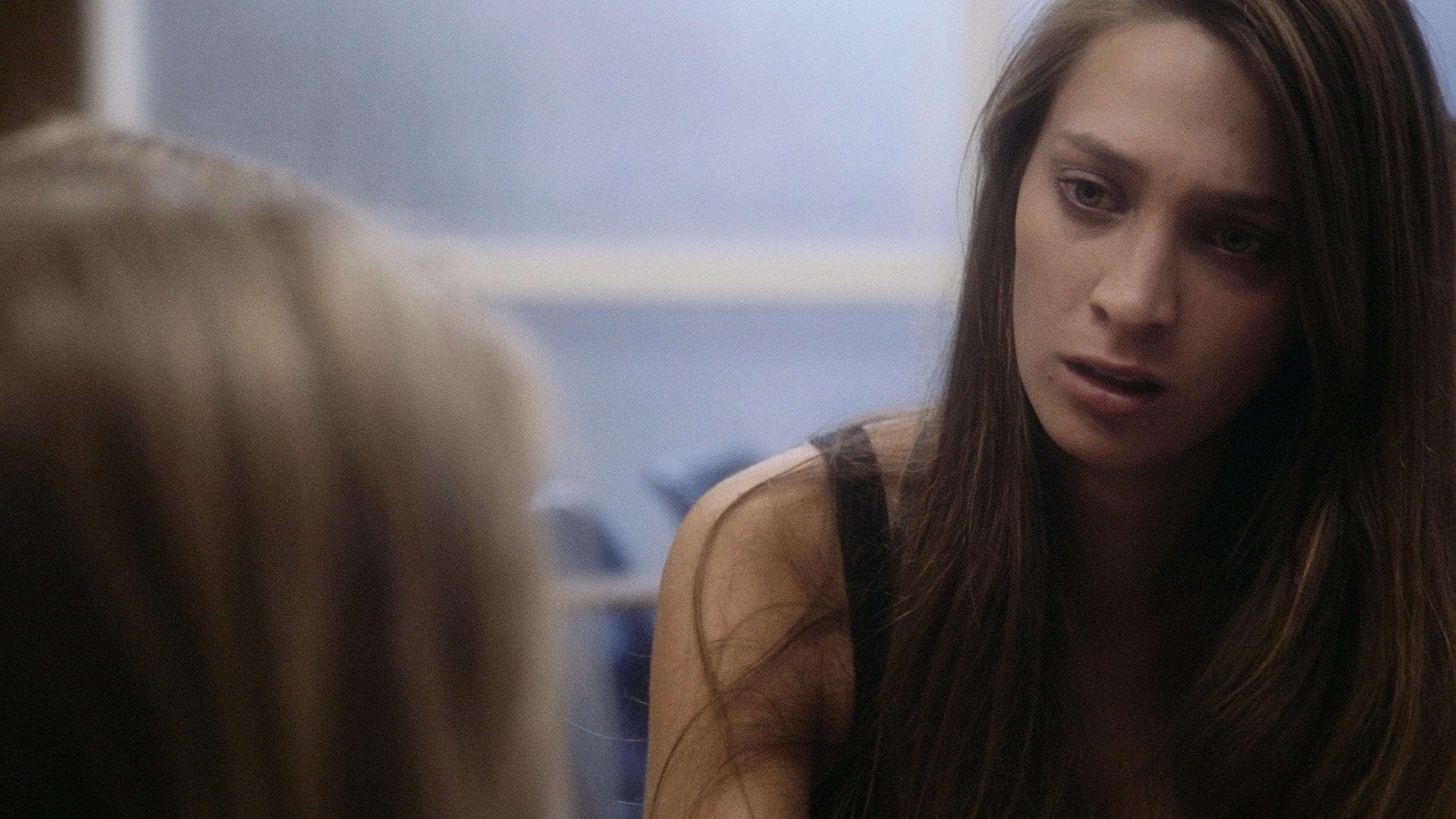 Sam (Stell Bahrami, right) reveals her secret to Emily (Jayna Sweet).