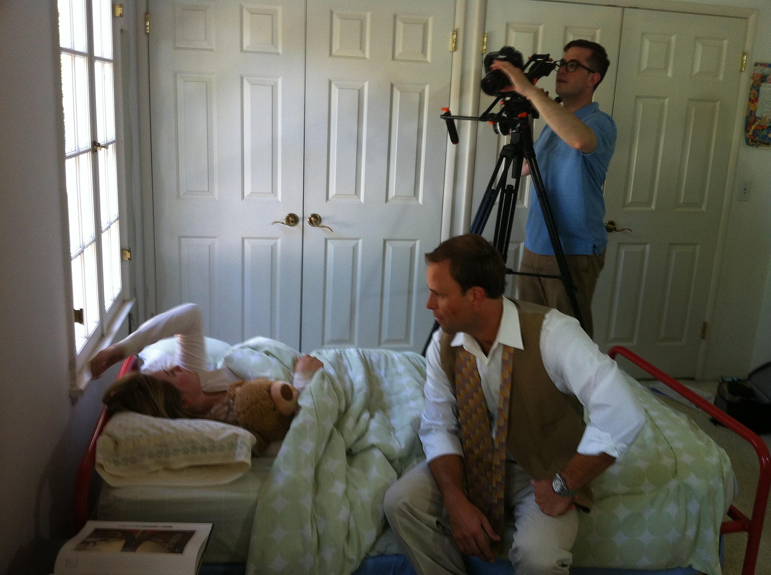 Director/DP Benjamin Walter shoots a scene with Jayna Sweet (Emily) and Matt Cooper (Dad) in Emily's bedroom.
