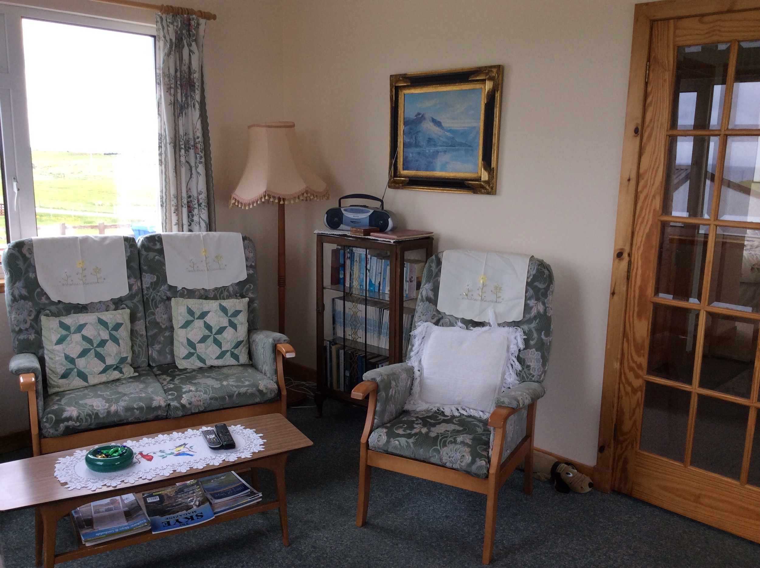 The sitting room is a comfortable size with four large picture windows,  over-looking the Minch and the Outer Hebrides.