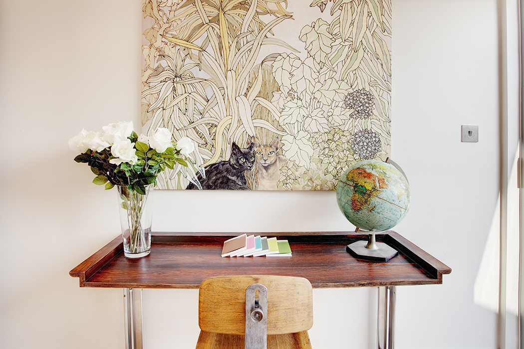 Modern desk with globe and flowers