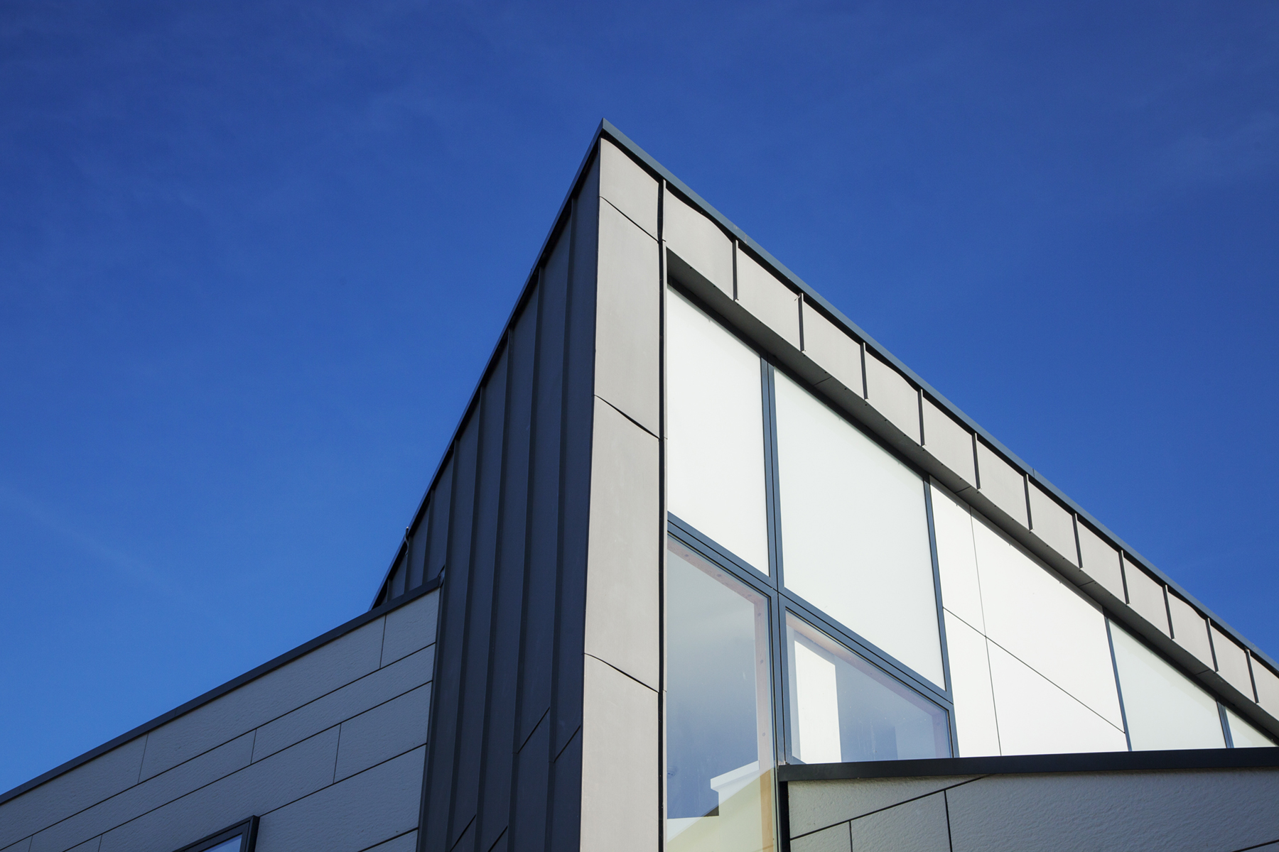 Modern church architectural exterior shot against a blue sky
