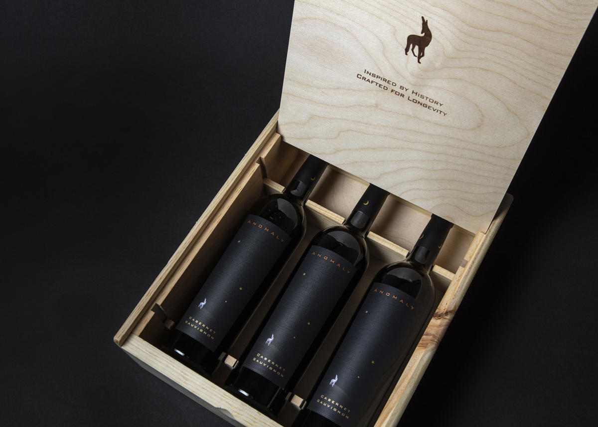 Wood box with three bottles