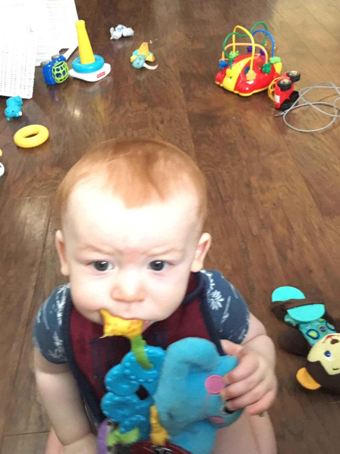 Joshua in a mess of toys