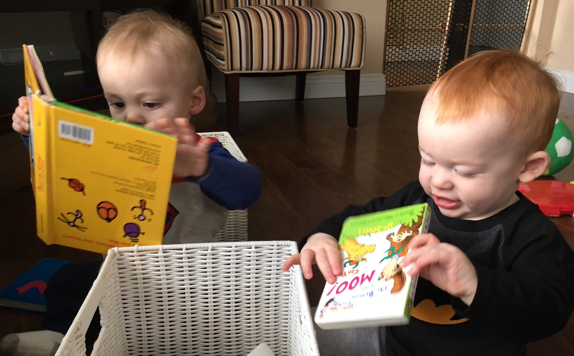 Julian and Joshua love books even if they're upside down.
