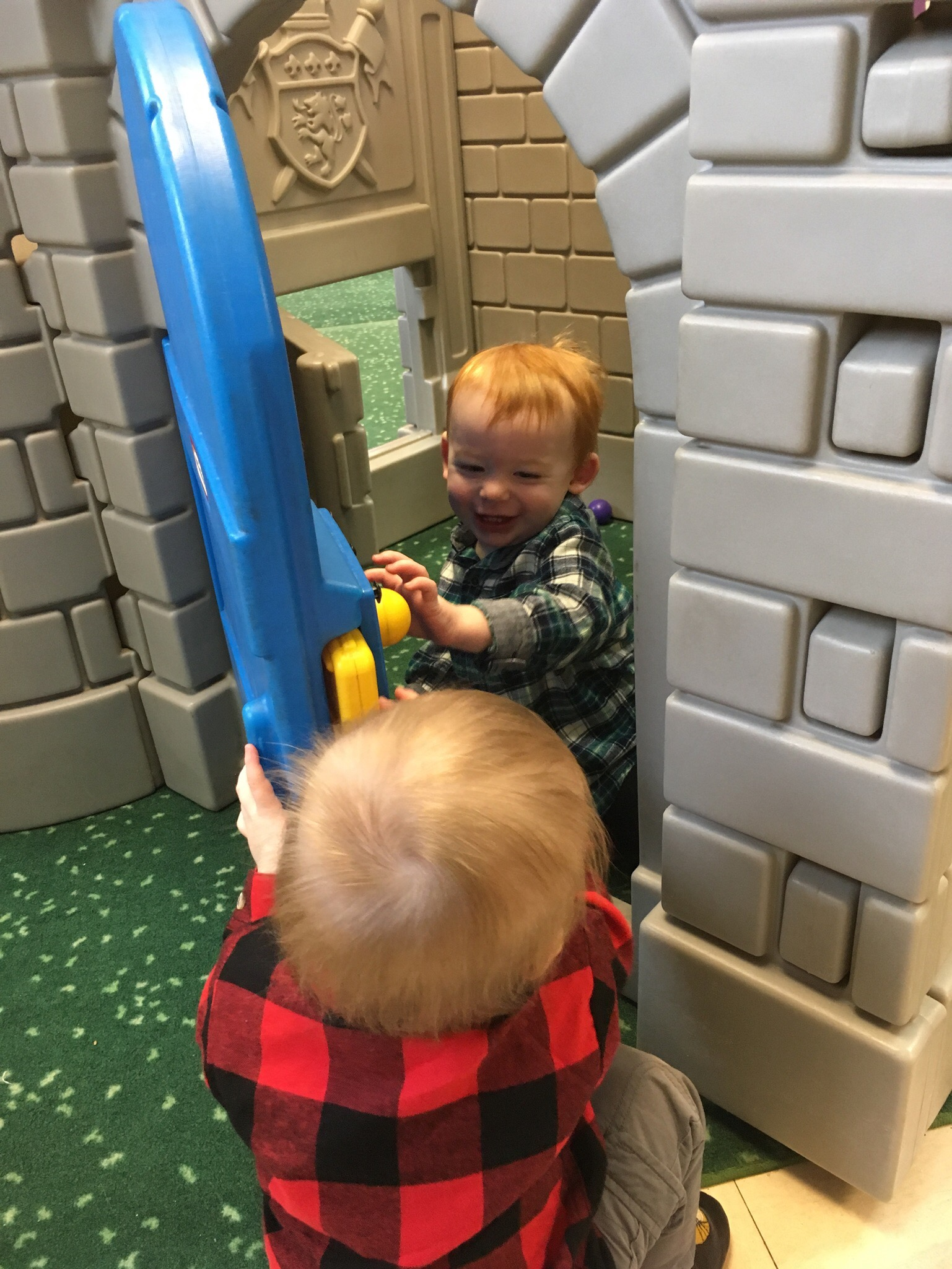 They love playing with doors! This door is at the Seesaw Center, a non-profit indoor play place near our house.