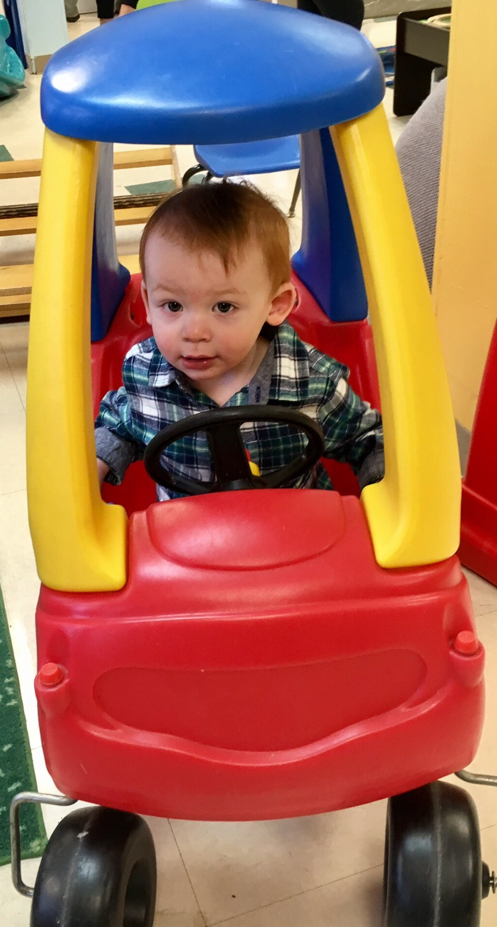 Joshua learning to drive at the Seesaw Center.