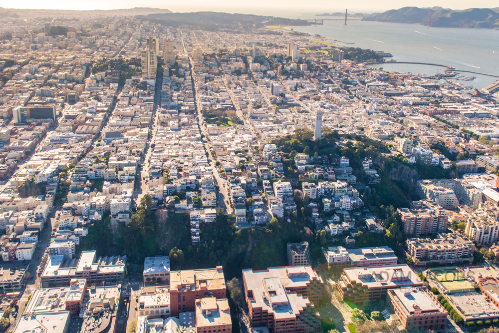 Being able to quickly change the camera settings manually allows you to cope with tricky lighting situations such as this aerial photo. The sun was facing directly towards me and I had to adjust ISO and aperture to compensate and get the look I wanted, to feature Coit Tower looking all the way out to the Golden Gate Bridge.