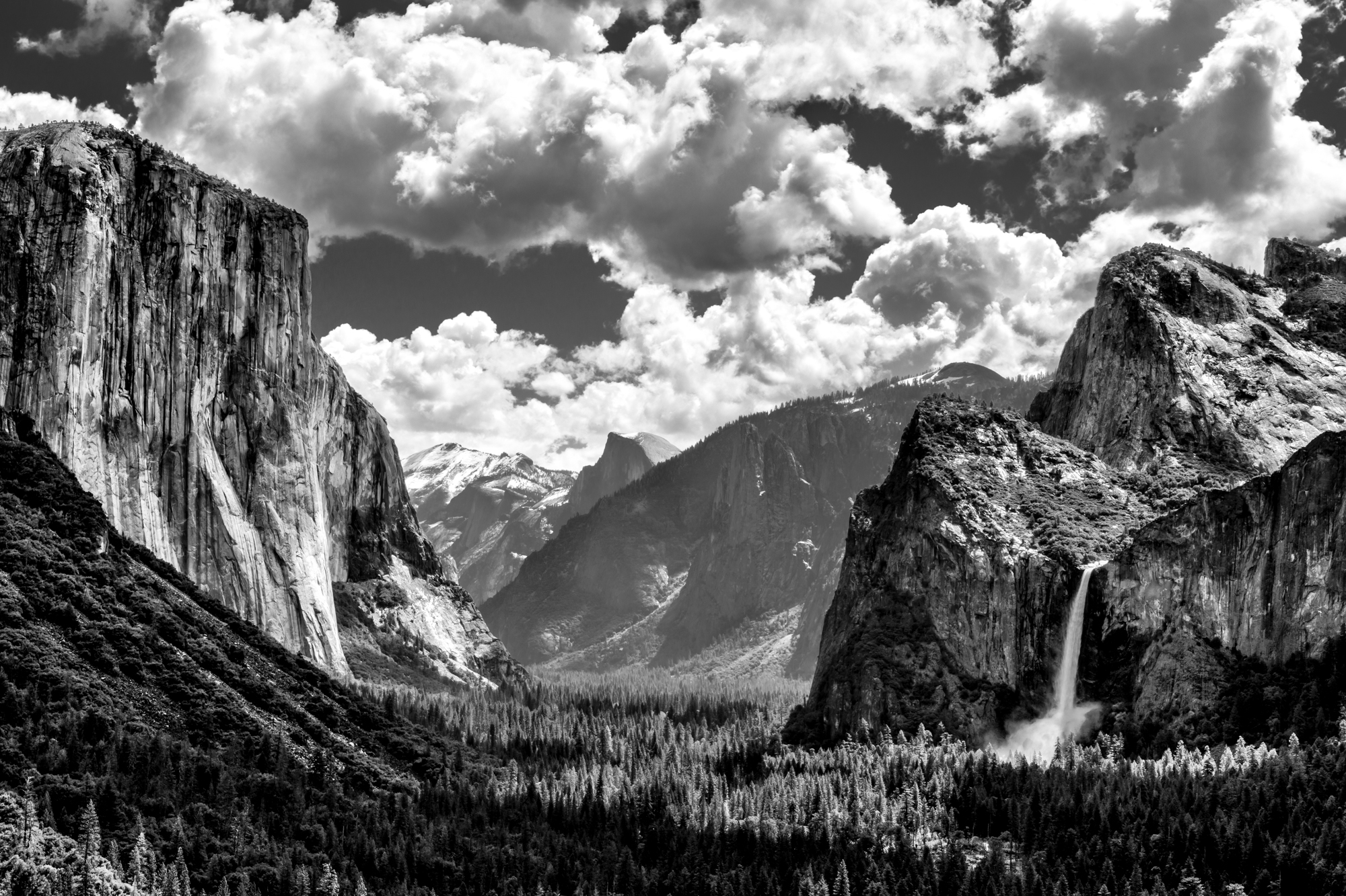 After visiting this spot so many times, this was one the best times I've seen the light falling so perfectly on El Capitan on the left and Bridal Falls on the right. I also love the big booming clouds and how you can see Half Dome in the background with a little covering of snow. There is a reason this spot is known as Inspiration Point!! This photo is going to look awesome printed out huge.
