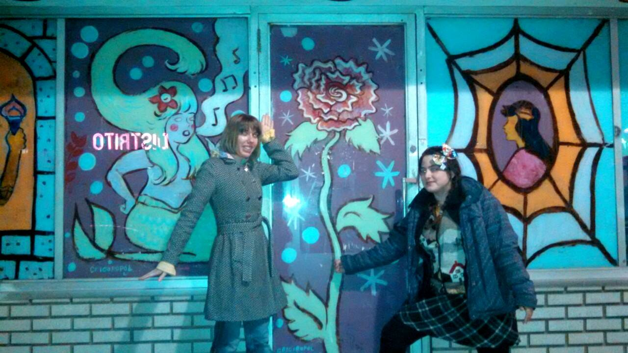 Dre Grigoropol (right) and her mural outside Locust Moon Comics, with Mindy Indy.