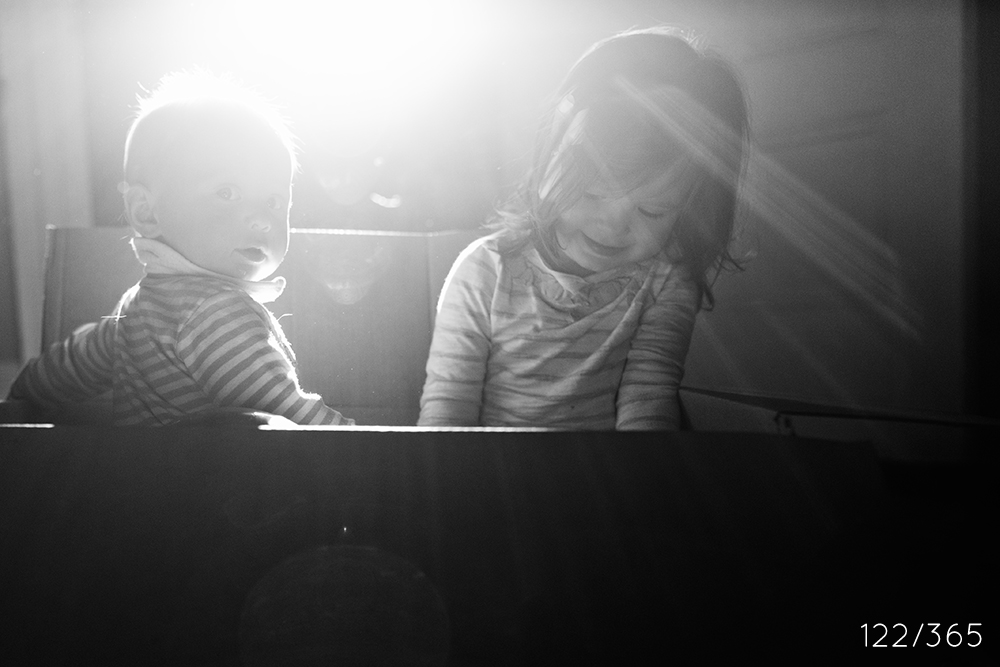 My nephew and niece in the light, in a box, together.