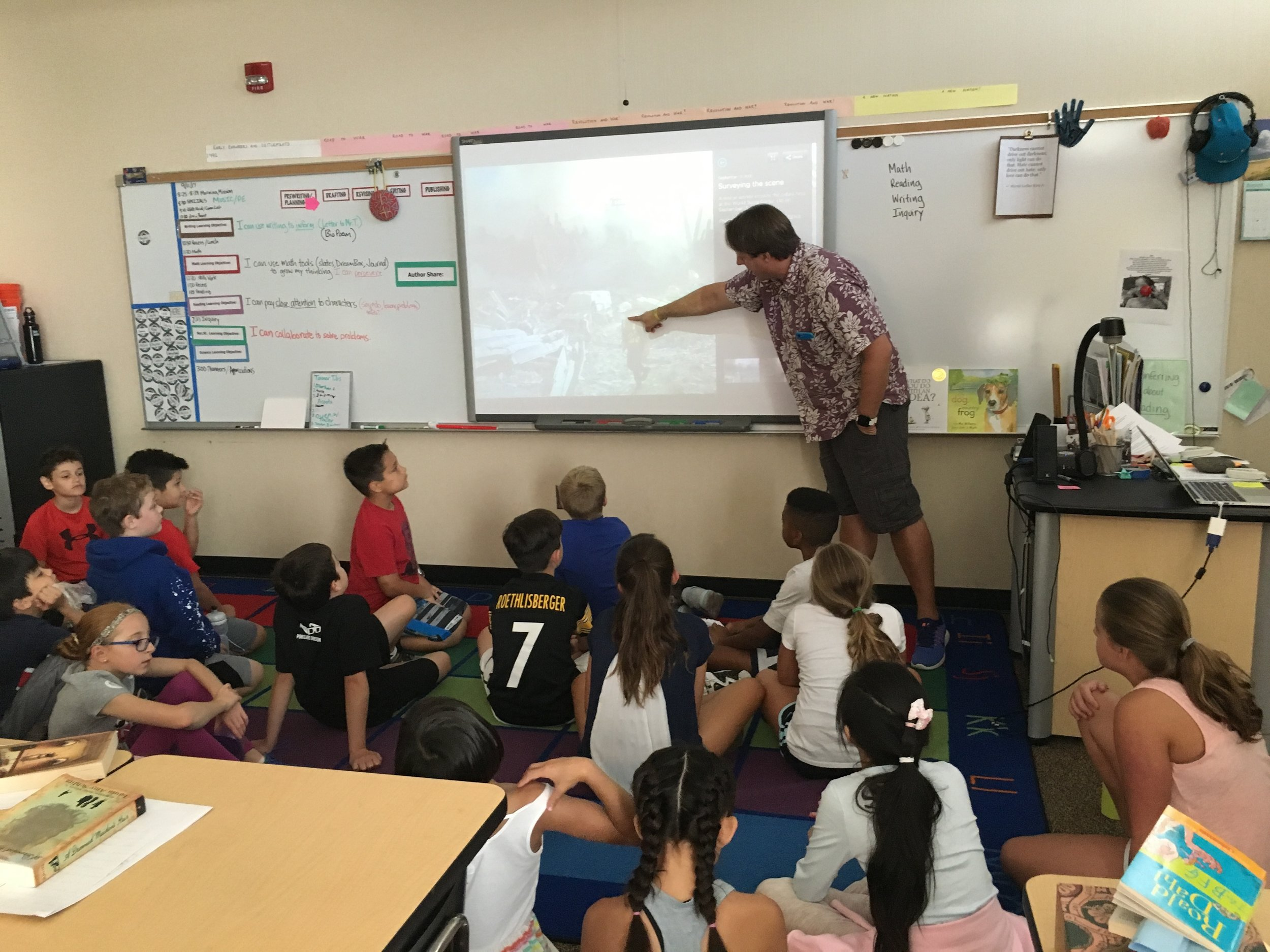 Fifth grade students in Mr. Traller's classroom discuss first responders and 9/11.  Later students expressed their feelings through an art project.