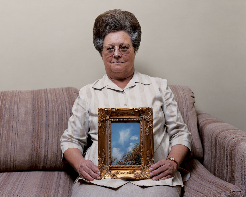 Bonnie (with a photograph of an Angel)  , Port Gibson, Mississippi, 2000  From the Sleeping By the Mississippi series  Alec Soth