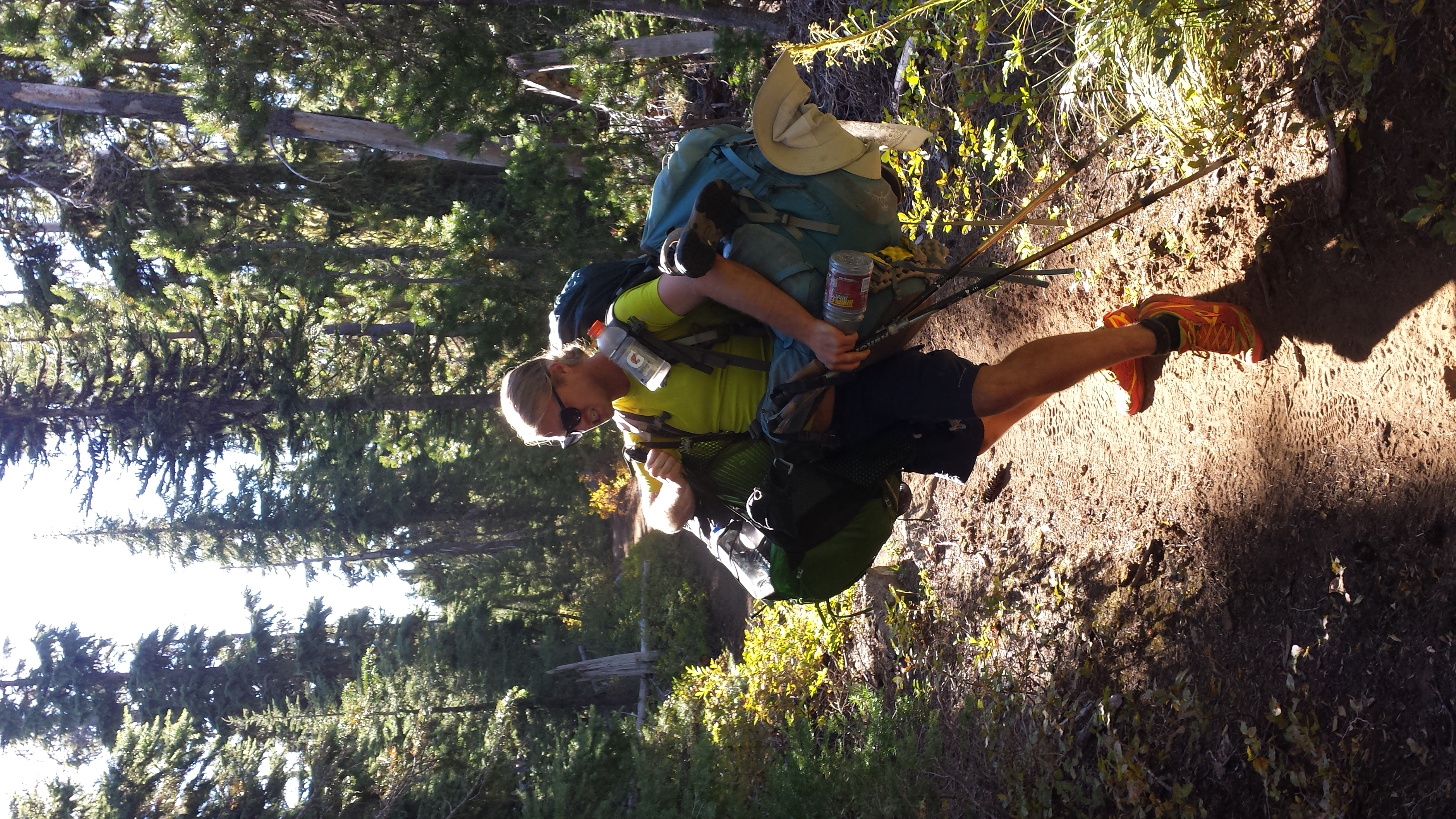 Dr Fierce carries his, my and Any Minute's packs to our shared camp.