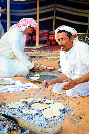 Tribal men making the bread for breakfast