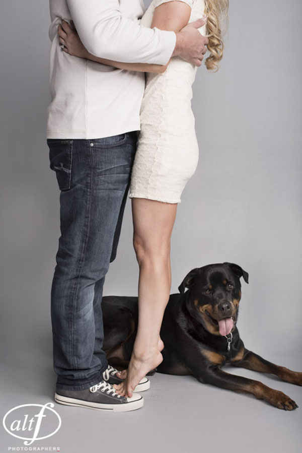 Tiny little feet and a puppy took center stage in the engagement photos.