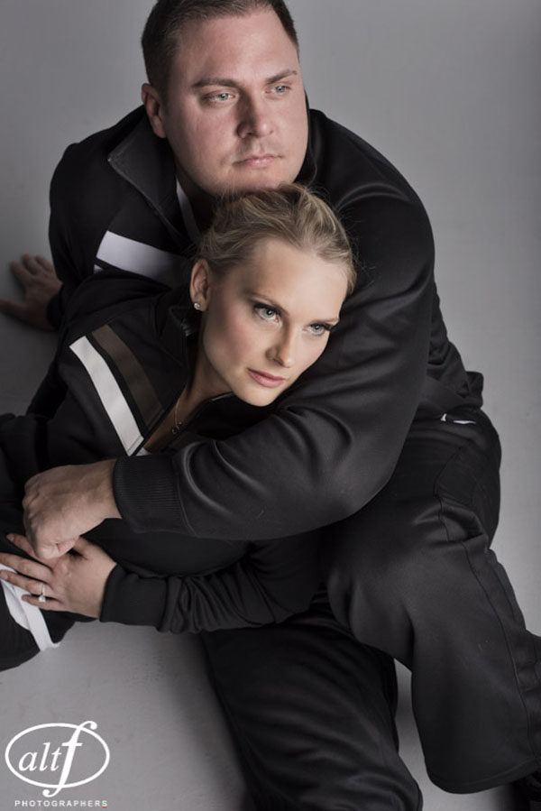 The super active couple posed in track suits for a seies of engagement photos.